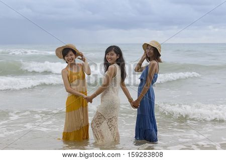 younger asian woman friend relaxing vacation time at sea beach happiness emotion