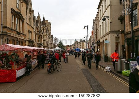 Broad Street Oxford UK 27th November 2016: Oxford's Christmas Light Festival on Broad Street with performances workshops market stalls with seasonal food and drink.
