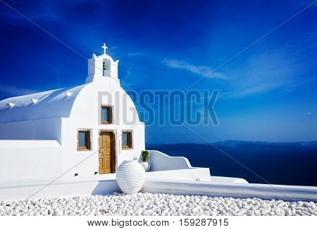 beautiful details of Santorini island - typical house with white walls and blue Aegan sea, Greece, retro toned