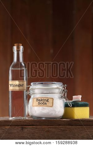 baking soda and vinegar on wooden background poster