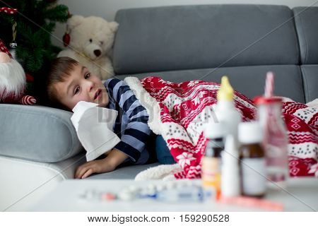 Sick Little Child, Boy, With High Fever Sleeping On The Couch At Home