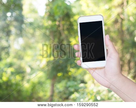 holding smart phone device. Smart phone with blank screen. GPS navigation maps concept.