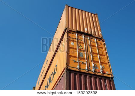 OAKLAND, CALIFORNIA - FEBRUARY 26, 2015: The average container ship can hold 3, 500 containers. Shipping containers are organized and placed algorithmically for efficient transport.