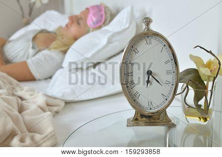 Alarm Clock And Sleeping Woman
