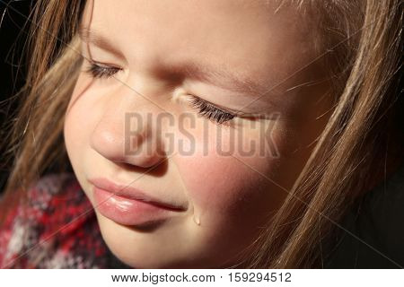 Close up view of crying little girl