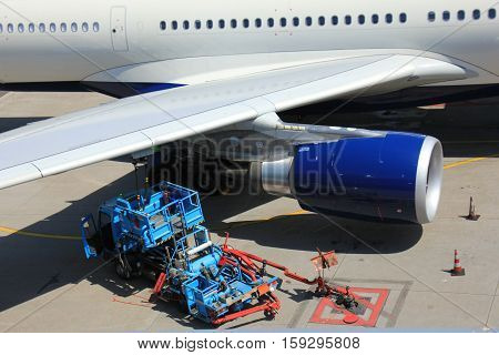 Fueling an airplane at airport tarmac platform