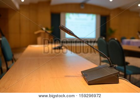 Table microphone on conference table - stock photo