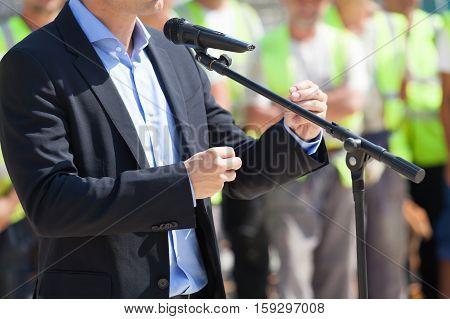 Public speaking. Presentation. Businessman or politician is giving a speech.