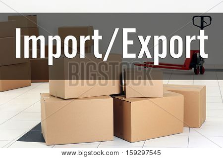 Text IMPORT/EXPORT on background. Cardboard boxes at storehouse. Wholesale and logistics concept.