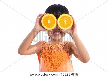 Happy Asian Chinese Little Girl Using Orange As Glasses