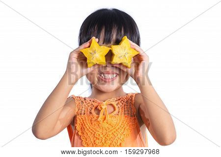 Happy Asian Chinese Little Girl Using Starfruit As Glasses