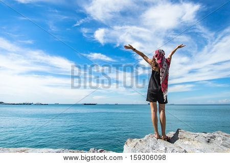 Female bystander by beautiful beaches and blue skies.
