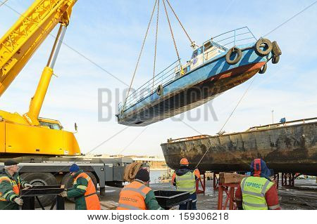 MOSCOW, RUSSIA - NOVEMBER 11, 2016: State Unitary Enterprise Mosvodostok performs recovery vessels on coastal winter parking. The ship is set on the winter parking place.