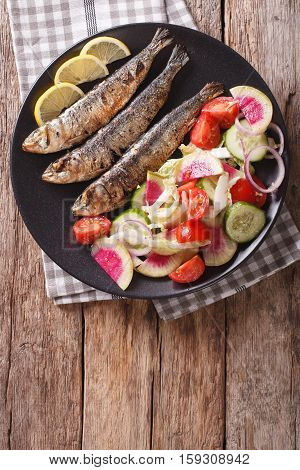 Grilled Sardines With Fresh Vegetable Salad Close-up. Vertical Top View