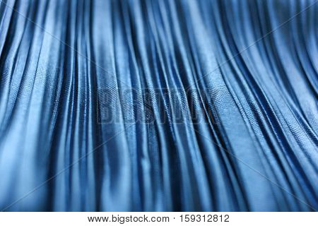 Blue textured crinkled fabric closeup. Selective focus.