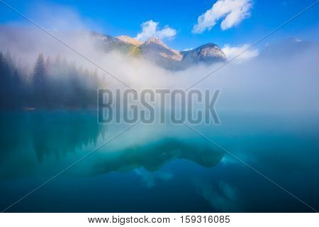 Misty autumn morning in the mountain Emerald Lake. Canada, Yoho National Park