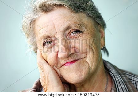 Old grandmother face on a grey background