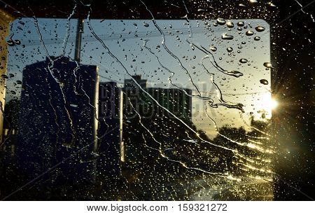 Close up view of water drop on car window during washing by automatic washing machine
