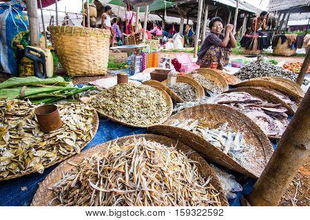 Inle lake Myanmar - 5 July 2015: Woman sells fish on local Asian market on Inle lake Myanmar