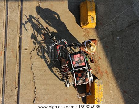 Traditional Tricycle Rider in Myanmar Top View
