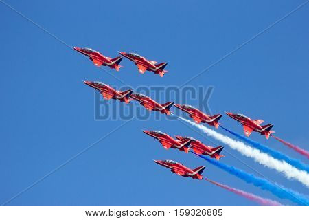 VOLKEL NETHERLANDS - JUN 15 2013: The RAF demonstration team Red Arrows performing aerobatics at the Royal Netherlands Air Force Open Day.