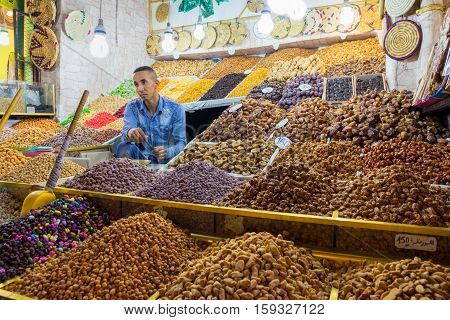 MARRAKECH MOROCCO - APR 29 2016: Unidentified man selling dried fruits in the old medina of Marrakech.