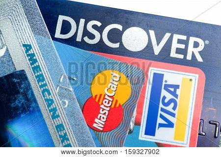 Close up of credit cards with Discover,American Express,visa and MasterCard logos on white background,illustrative editorial
