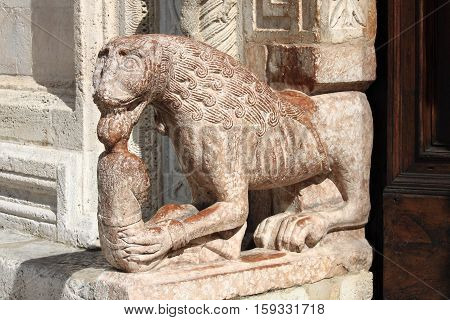Lateral statue at the entrance of St. Rufino Cathedral in Assisi, Italy