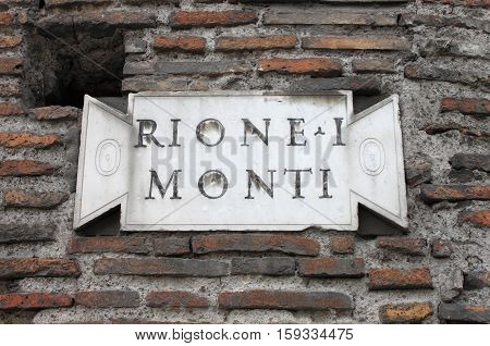 Old district plate in the downtown of Rome, Italy