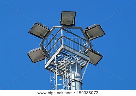park light poles with white clouds and blue sky backgrounds.