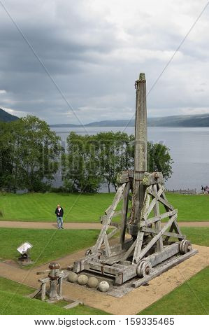 URQUHART CASTLE SCOTLAND - CIRCA AUGUST 2015: trebuchet modern replica at the medieval castle of Urquhart