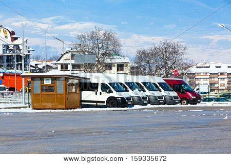 Bansko, Bulgaria - November 30, 2016: Winter ski resort with row of ski buses in Bansko, Bulgaria