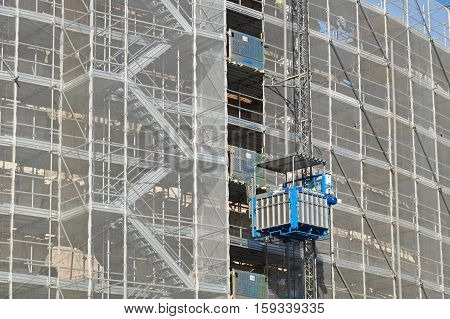 ROME, ITALY - JUNE 24 : The Colosseum in Rome with restore works in progress on the facade. The Colosseum or Coliseum, also known as the Flavian Amphitheatre in Rome, Italy on June 24, 2015.