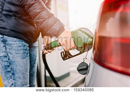 Woman Refueling Her Small Silver Car