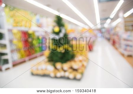Abstract Blur Background Of Christmas Tree In Department Store