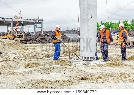 Zrenjanin Vojvodina Serbia - May 28 2015: People are working to assembly concrete pillar on new edifice.