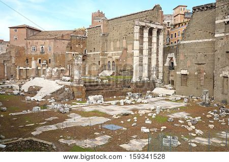 View of Roman Forum, focus on the Saturn's Temple in foreground. Ancient roman ruins in Rome,