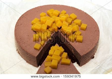 cut piece cheesecake cheese chocolate on white boards closeup