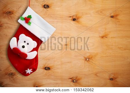 Red christmas sock and wooden wall. Christmas