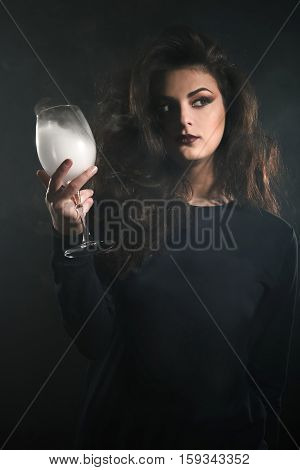 Young Woman Holding A Glass Of Smoke