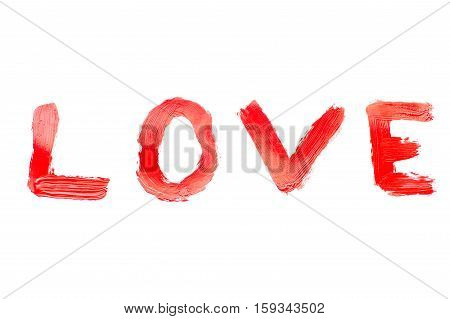 Red paint is written the word love.