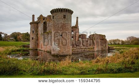 Caerlaverock Castle is a moated triangular castle first built in the 13th century. It is located on the southern coast of Scotland, 11 kilometres south of Dumfries