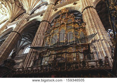 SALAMANCA, SPAIN - SEPTEMBER 24, 2013: Organ of the Gospel in the New Cathedral created by Pedro de Echevarria in 1744.
