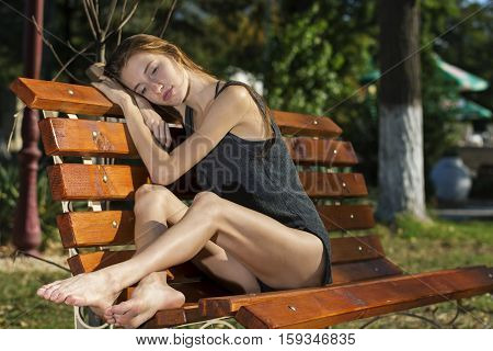 Ballerina resting on bench after dance practice