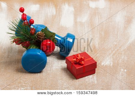 Christmas Sport Composition With Dumbbells, Red Gift Box, Berries, Spruce