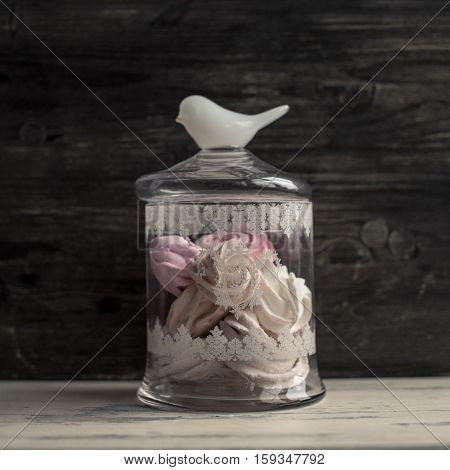 Vintage jar of marshmallow on a gray background.