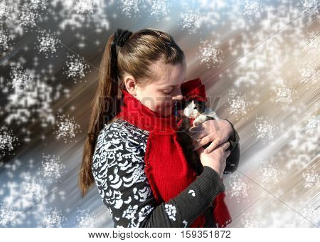 The girl in the red scarf. Girl and kitten. Winter day. Red hat and red scarf