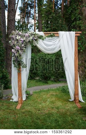Beautiful wedding arch decorated with flowers in the Park.