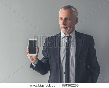 Handsome Mature Businessman With Gadget