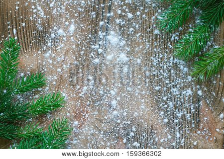 Christmas Tree Green Branches On Winter Snowflakes Wooden Space Background
